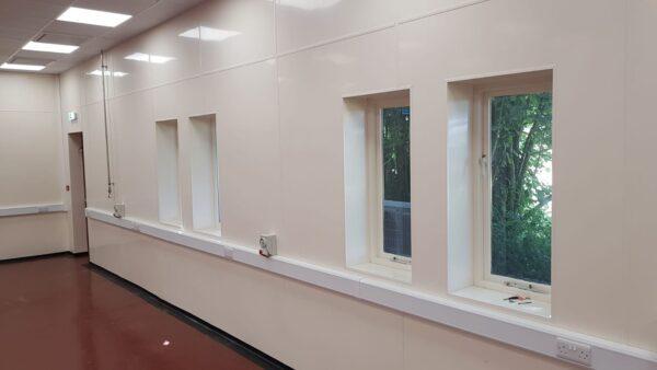 cream hygienic pvc wall cladding around windows
